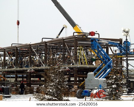 Alberta oil refinery component is assembled in Edmonton for delivery by heavy truck to Fort McMurray, AB. Canada Feb. 2009 - stock photo