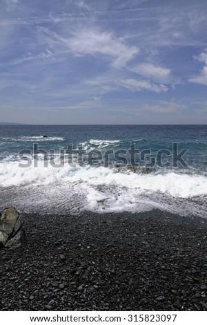 Albo with a black gravel beach, Cap Corse, west coast, Corsica, France - stock photo