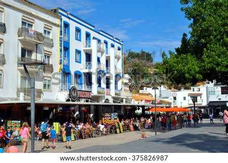 Albufeira, Algarve, Portugal - October 26, 2015 : Tourists eating and drinking in restaurants in the old town of Albufeira, Portugal - stock photo