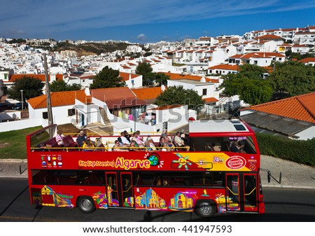 ALBUFEIRA, ALGARVE, PORTUGAL - September 24, 2012: Tourists travel through the old town Albufeira on the open tour bus, Algarve, Portugal - stock photo