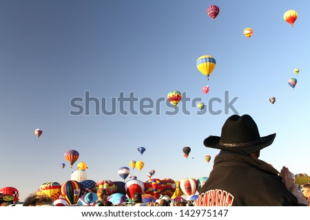 ALBUQUERQUE, NM - OCTOBER 1: Balloons float in the sky at the International Balloon Fiesta on October 1, 2011 in Albuquerque, NM. This is the world's largest hot air balloon festival. - stock photo