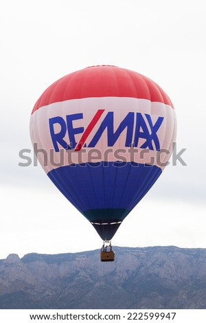 Albuquerque, NM, October 8:  The Remax balloon floating near the Sandia Mountains at the Balloon Fiesta in Albuquerque, New Mexico on October 8th, 2014. - stock photo