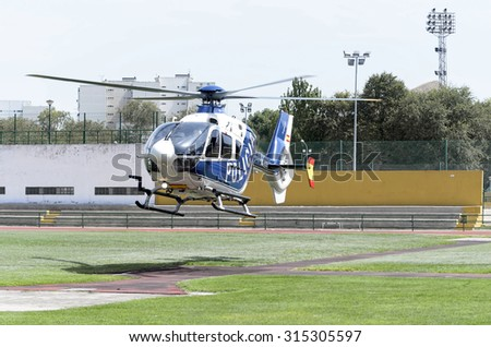 ALCALA DE HENARES, SPAIN - AUGUST 29th 2015: Helicopter is taking off, after a show of spanish armed forces, in Alcala de Henares, on August 29th 2015. - stock photo