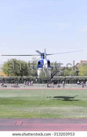 ALCALA DE HENARES, SPAIN - AUGUST 29th 2015: Helicopter,of spanish police,is taking off with parachutists inside, during an exhibition of spanish armed forces, in Alcala de Henares,on August 29th 2015 - stock photo