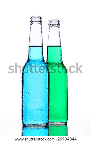 alcohol bottles with blue and green liquid, wet surface, isolated on white - stock photo