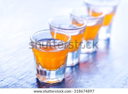 alcohol drink in glasses - stock photo