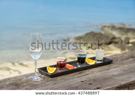 Alcohol drink on beach - stock photo
