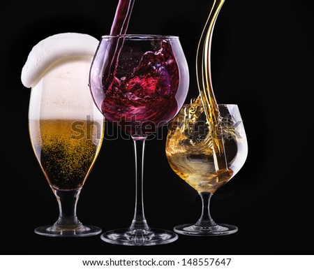 alcohol drinks set isolated on a black background - beer,wine,scotch - stock photo