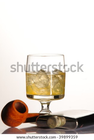 Alcohol, pipe and flask - stock photo