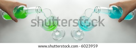 Alcohol pour in a wine glass from a bottle. Two mirror variants of one photo. It is easily possible to choose suitable color scale. - stock photo