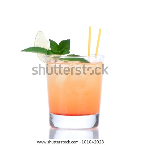 Alcohol tequila sunrise or margarita cocktail with crushed ice, green mint, yellow straws, lime in small glass isolated on white background - stock photo