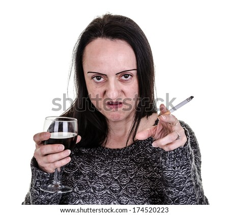 alcoholic, aggressive woman pointing while drinking red wine and smoking  - stock photo
