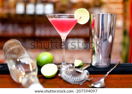 alcoholic cocktail drink with vodka and triple sec on counter at bar - stock photo