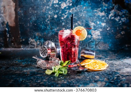 alcoholic cocktail with lime and mint garnish - stock photo