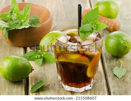 Alcoholic cocktail with rum, lime  and ice. Selective focus - stock photo