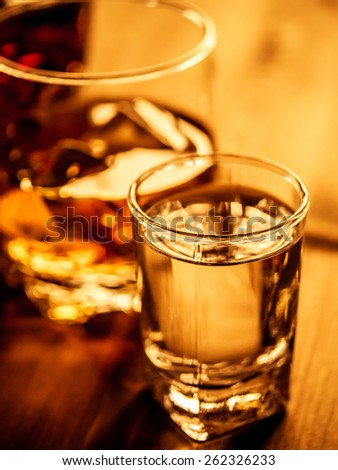 Alcoholic cocktails on a wooden table - stock photo