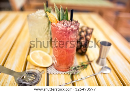 alcoholic cocktails served cold in bar, restaurant. Gin and tonic lime cocktails  - stock photo
