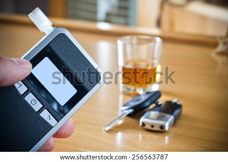 Alcoholic drink, breathalyzer and car keys - do not drink and drive concept - stock photo