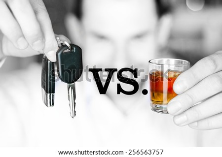 Alcoholic drink versus car keys in hands - do not drink and drive concept - stock photo