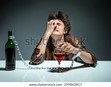 Alcoholic drunk man / photo of youth addicted to alcohol, alcoholism concept, social problem - stock photo