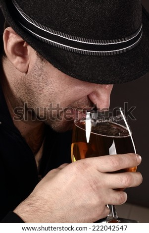 alcoholic in despair drinking beer, bad teeth, drunk man - stock photo