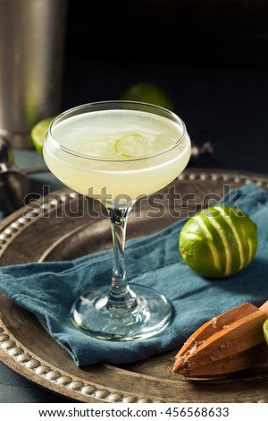 Alcoholic Lime and Gin Gimlet with a Garnish - stock photo