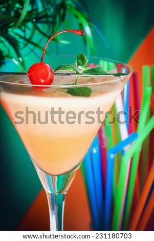 Alcoholic summer recreational drink with cherry  - stock photo