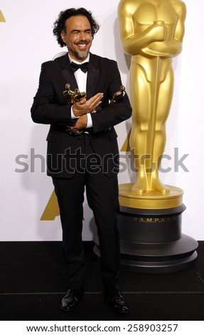 Alejandro Gonzalez Inarritu poses in the press room during the 87th Annual Academy Awards at Loews Hollywood Hotel on February 22, 2015 in Hollywood, California. - stock photo