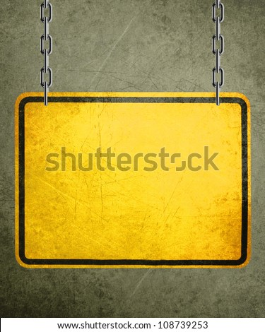 Alert yellow sign hanging by metal chain, conceptual image for under construction and coming soon - stock photo