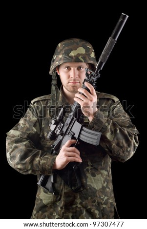 Alerted soldier raised m16 in studio. Upperhalf - stock photo