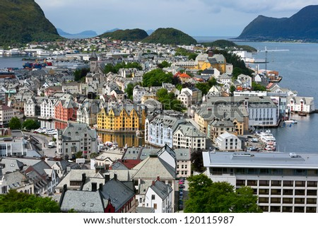 Alesund is a sea port, and is noted for its unique concentration of Art Nouveau architecture. - stock photo