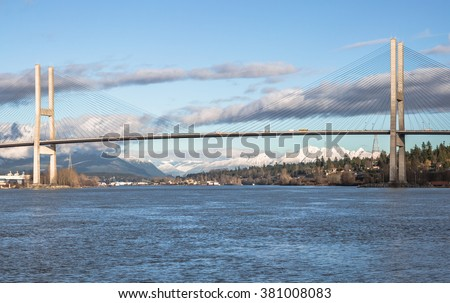 Alex Fraser Bridge over the Fraser River between New Westminster and Delta British Columbia, Canada - stock photo
