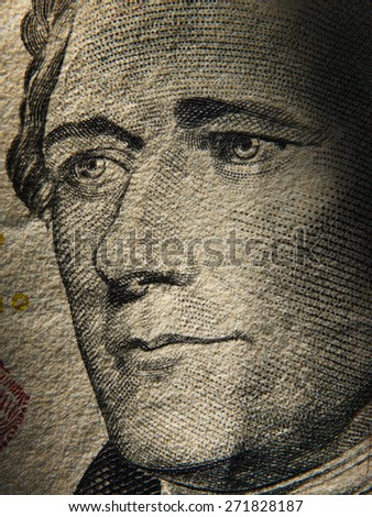 Alexander Hamiltons portrait is depicted on painted on the $ 10 banknotes. Close up - stock photo