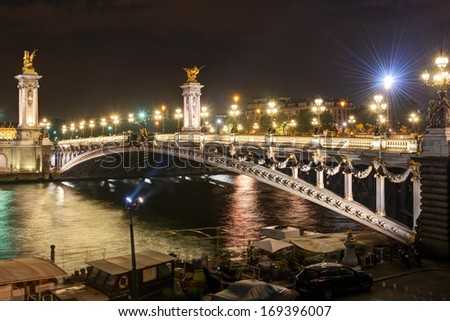Alexandre III bridge at night in Paris, France - stock photo