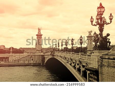 Alexandre III bridge in Paris at sunset, France - stock photo