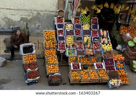 ALEXANDRIA - JAN 27: a Egyptian peddler sat beside a fruit shop.Jan 27,2013 in Alexandria,Egypt. - stock photo