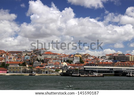 Alfama district of Lisbon seen from the Tagus River - stock photo