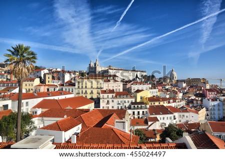 Alfama, historic district in Lisbon, Portugal. Touristic destination - stock photo