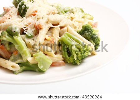 Alfredo chicken with penne pasta and vegetables. - stock photo