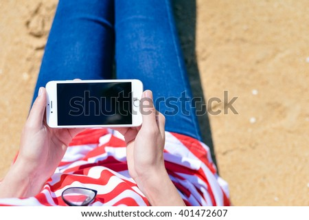 Algarve, Portugal - March 15, 2016: Person sitting holding iPhone 6 smartphone in hands. Top view closeup  - stock photo