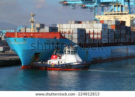 ALGECIRAS, SPAIN - DECEMBER 24: Container ships being loaded in the Mediterranean port of Algerciras, the 6th busiest container port in Europe. On December 24, 2013 in Algeciras, Spain. - stock photo