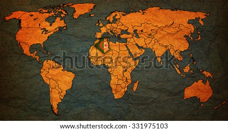 algeria flag on old vintage world map with national borders - stock photo