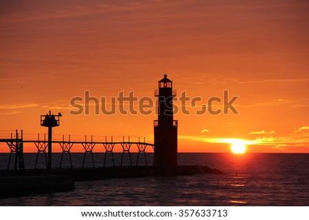 Algoma lighthouse at sunrise - stock photo