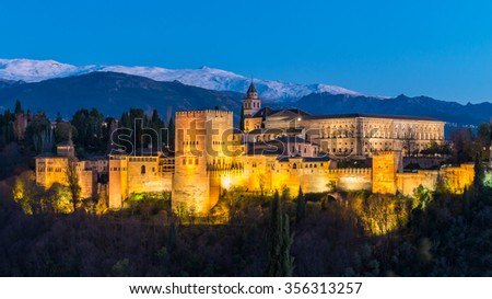 Alhambra Aerial view Beautiful Panorama of Ancient Alhambra Palace Architecture Granada Famous Landmark, Spain with Sierra Nevada mountain background at night dusk twilight sunset in Summer, Andalusia - stock photo