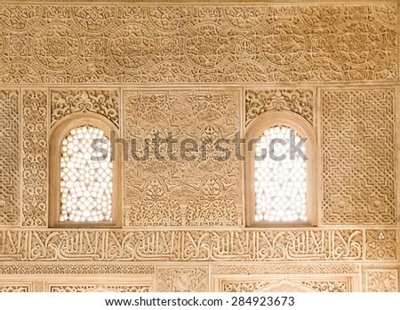 alhambra ornate wall - stock photo