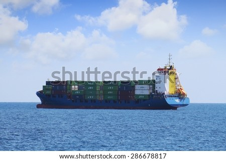 """ALICANTE, SPAIN   JUNE 02: The container ship """"NEUBURG"""" waits anchored for entering in the port of Alicante; Spain; on JUNE 2, 2015 in Alicante. - stock photo"""
