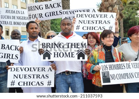 ALICANTE, SPAIN - May 14: Protestors holding Bring Back Our Girls signs for over 200 girls abducted by  Boko Haram from a school in Chibok, Nigeria. Alicante May 14, 2014.  - stock photo