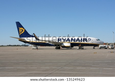 ALICANTE, SPAIN - NOVEMBER 25: Ryanair Boeing 737 on November 25, 2008 in Alicante airport, Spain. Ryanair operates fleet of 305 B737 aircraft and recently ordered 175 more. - stock photo