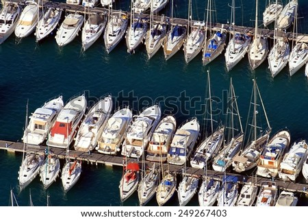ALICANTE, SPAIN - OCTOBER 12. Aerial view of docks with yachts and sail boats in Marina Calpe, on october 12, 2014 in Calpe, Spain. - stock photo