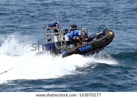 ALICANTE, SPAIN - OCTOBER 07: The coastguard patrol the Spanish Customs is sailing looking for drugs traffic over the coast, on October 07, 2013 in Alicante. - stock photo